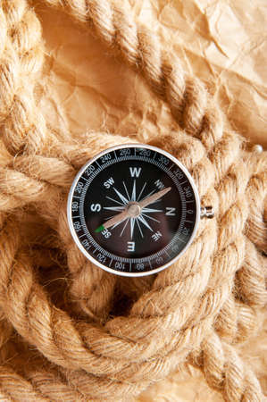 bygone: Compass and rope in travel and adventure concept