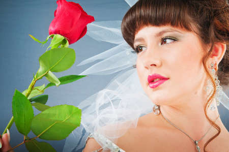 Beautiful bride with rose in studio shooting Stock Photo - 9010617