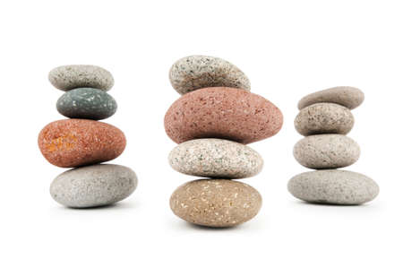 smooth stones: Stack of pebbles isolated on the white