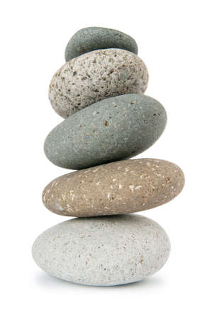 Stack of pebbles isolated on the white  photo