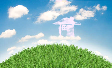 Cloud houses in the air over grass field Stock Photo