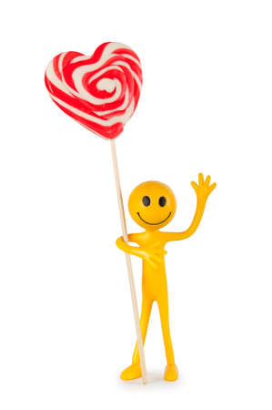 Smiley holding colourful lollipop isolated on white photo