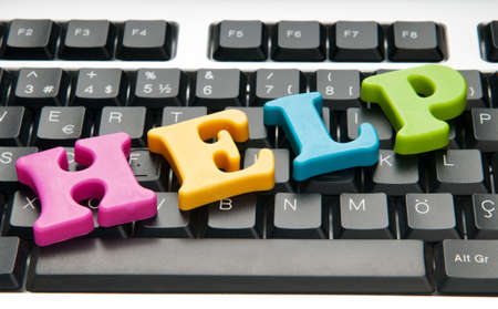 frequently asked questions: HELP concept with letters on keyboard Stock Photo