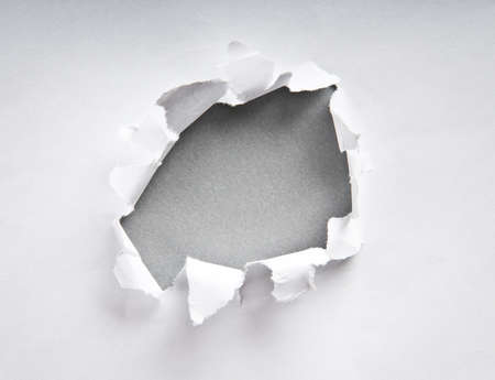 the sides: Hole in the paper with torn sides