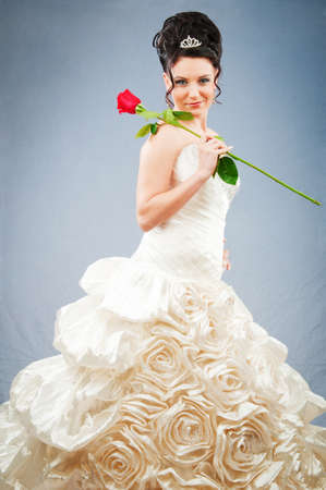 Beautiful bride with rose in studio shooting photo