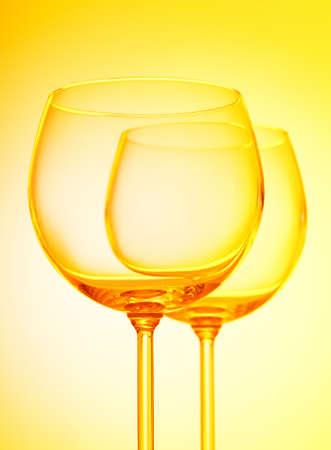 Wine glasses against gradient background photo