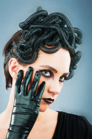 Woman depicting the concept og Evil (Medusa Gorgon) photo