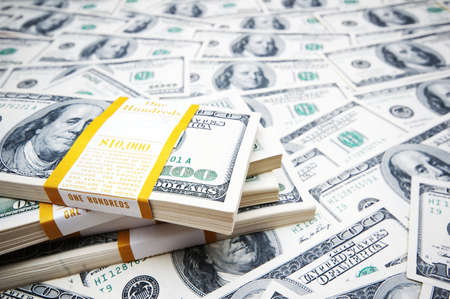 pay cuts: Background made of many dollars Stock Photo