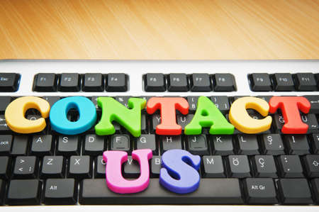 contactus: Contact us concept with letters on keyboard