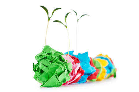 Paper recycling concept with seedlings on white Stock Photo - 9486855