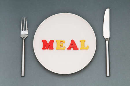 Plate with letters on the white background Stock Photo - 9487548