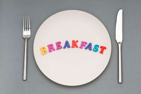 Plate with letters on the white background Stock Photo - 9487756