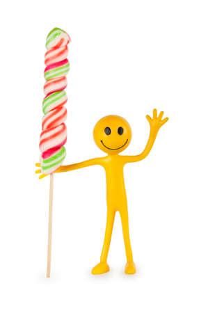 tabassum: Smiley holding colourful lollipop isolated on white Stock Photo