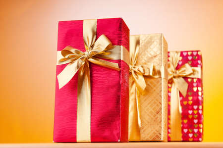 Celebration concept - Gift box against colorful background Stock Photo - 9487535