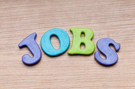 Employment concept with letters on background photo