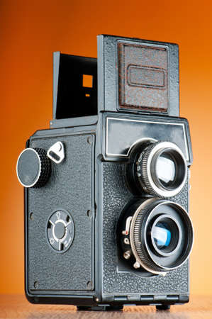 Vintage film camera against gradient background photo