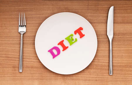 Plate with letters on the white background Stock Photo - 9541285
