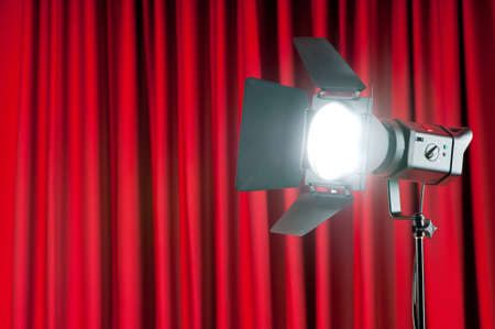 Curtains and projector lights wtih space for your text Stock Photo - 9541453
