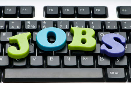 Employment concept with words on keyboard photo