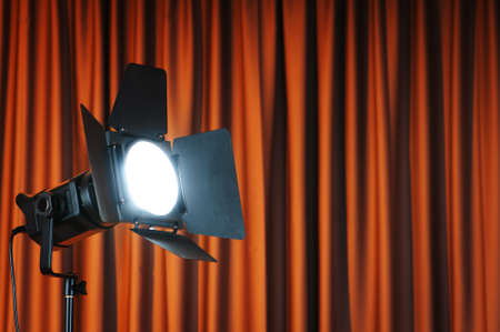 Curtains and projector lights wtih space for your text Stock Photo - 9548103