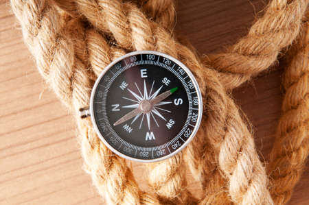 Compass and rope in travel and adventure concept photo