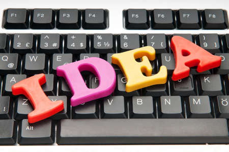 creative solutions: Ideas concept with letters on the keyboard Stock Photo