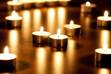 Many burning candles with shallow depth of field photo