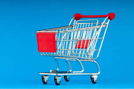 Shopping cart against the background Stock Photo - 9593554
