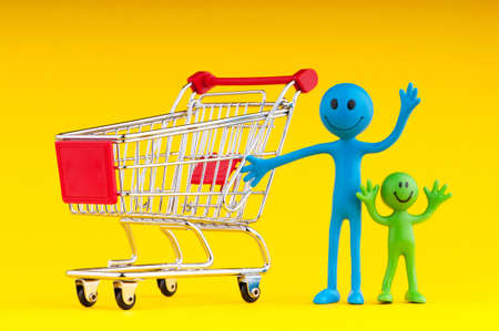 Happy family with shopping cart Stock Photo - 9590032