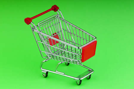 Shopping cart against the background Stock Photo - 9593843