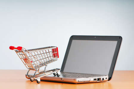 product cart: Internet online shopping concept with computer and cart Stock Photo