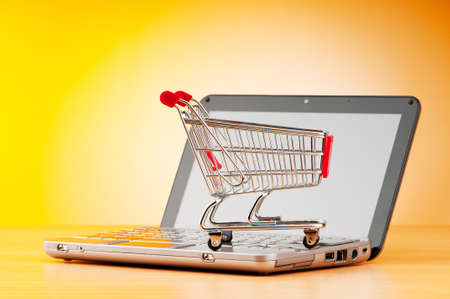 supermarket checkout: Internet online shopping concept with computer and cart Stock Photo
