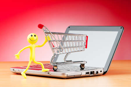 commerce communication: Internet online shopping concept with computer and cart Stock Photo