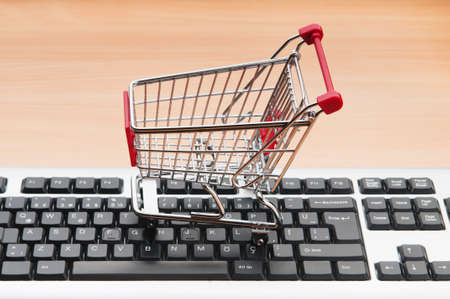 Internet online shopping concept with computer and cart Stock Photo - 9716537