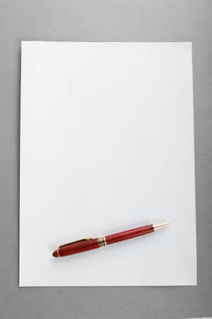 Pen on the sheet of paper Stock Photo - 9716863