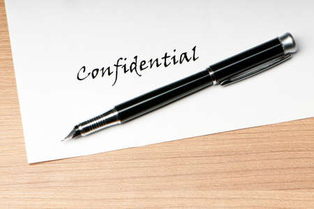 secret information: Pen and confidential message on white Stock Photo
