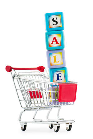 Shopping cart against the white background Stock Photo - 9714454
