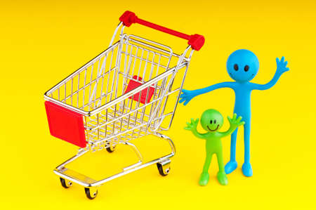 Happy family with shopping cart Stock Photo - 9716451