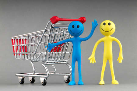 Happy family with shopping cart Stock Photo - 9715600
