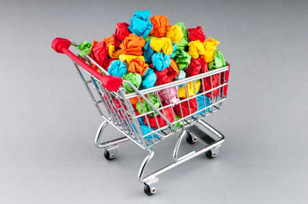 Recylcing concept with color paper and shopping cart photo