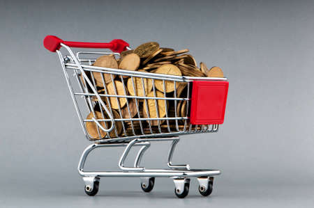 Shopping cart full of coins Stock Photo - 9715604