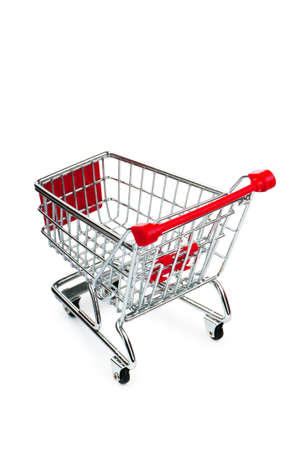 Shopping cart against the white background Stock Photo - 9714444