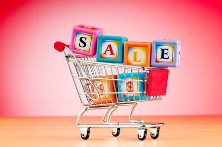 Shopping cart against the  background Stock Photo - 9715605