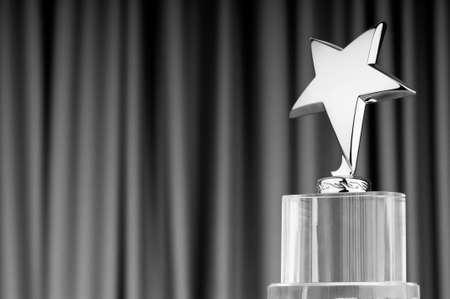 Ster award tegen gordijn achtergrond Stockfoto