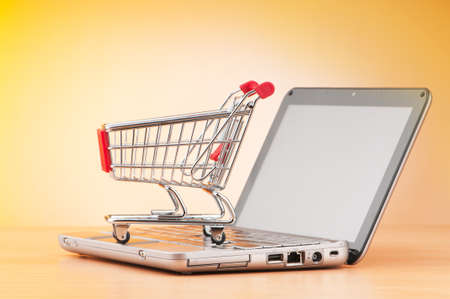electronic store: Internet online shopping concept with computer and cart Stock Photo