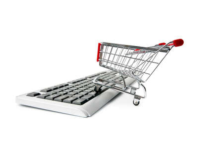 Internet online shopping concept with computer and cart Stock Photo - 9752578
