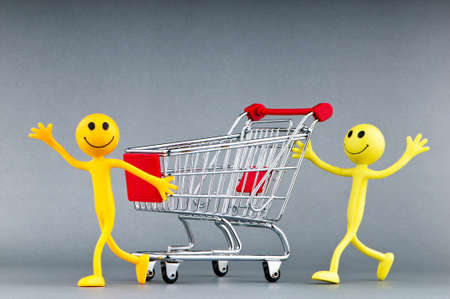 Happy family with shopping cart Stock Photo - 9752728