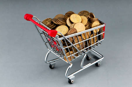 Shopping cart full of coins Stock Photo - 9752739