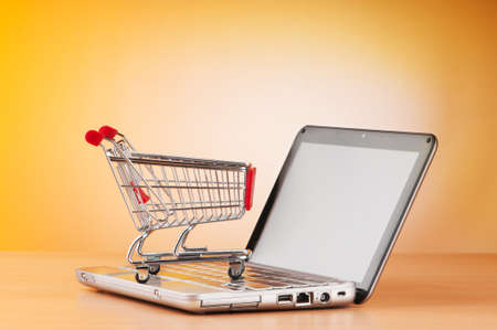 Internet online shopping concept with computer and cart Stock Photo - 9822039