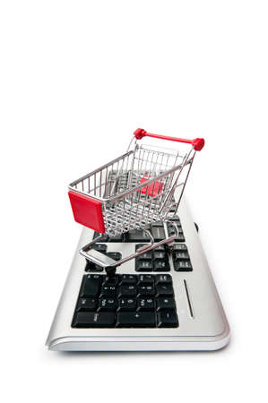 Internet online shopping concept with computer and cart Stock Photo - 9822003